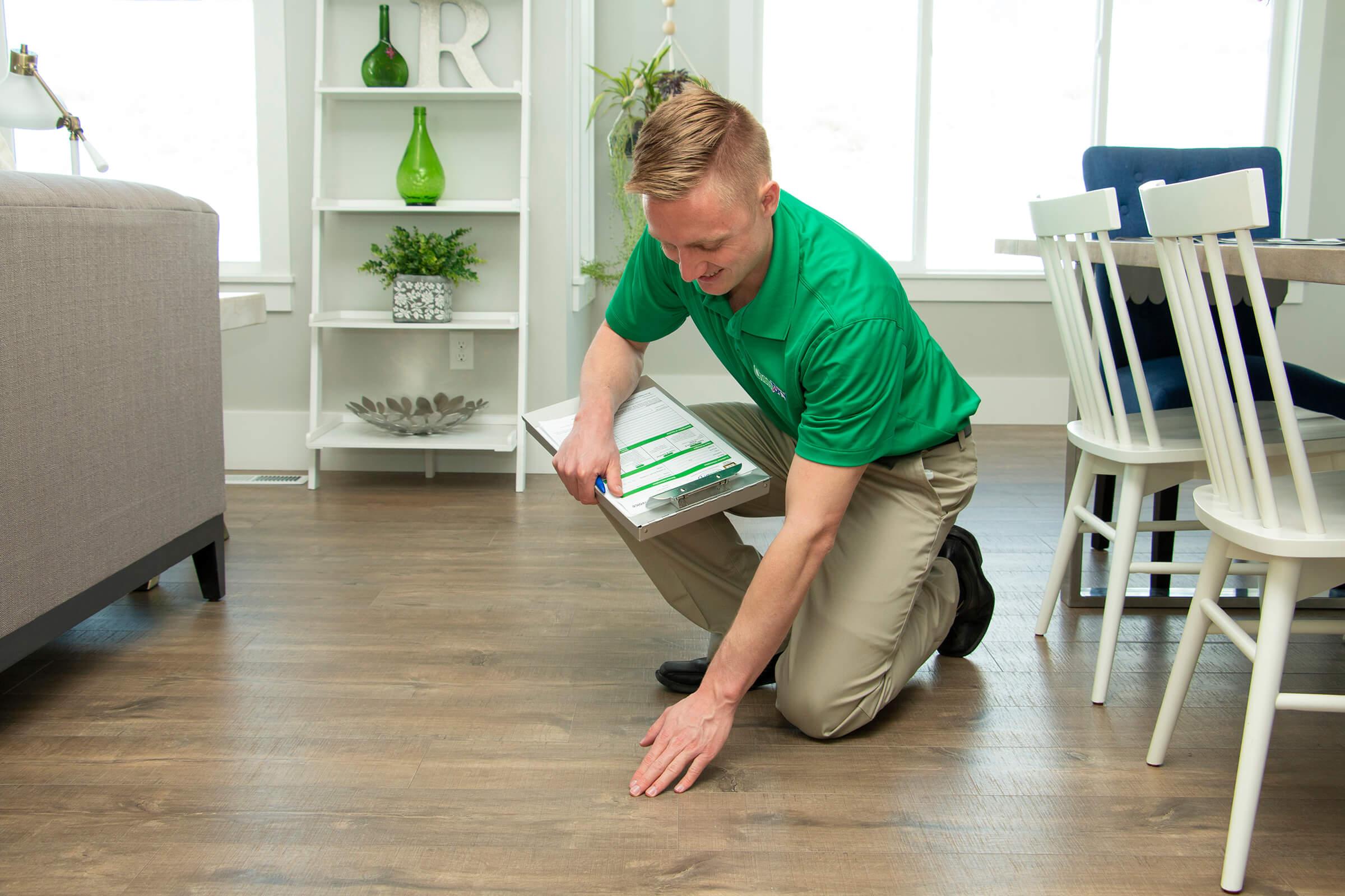 technician examining wood floor